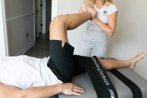 Woman providing fascial stretch therapy