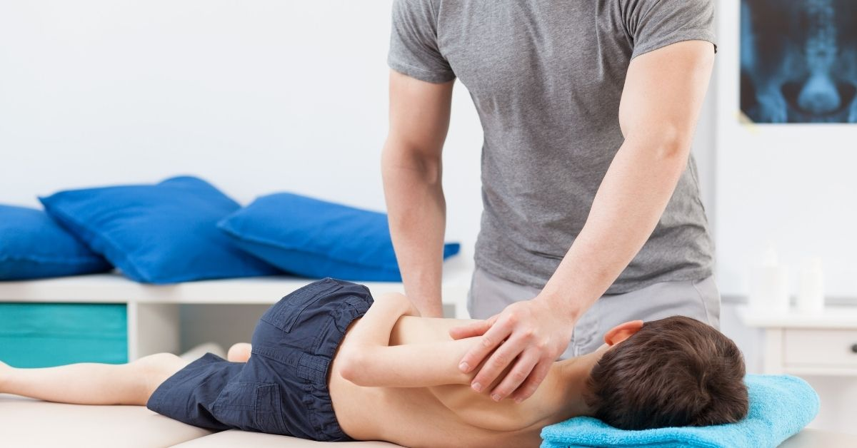 Pediatric Chiropractor Helping A Child Stretch Their Back   Pediatric Chiropractor Greenville, SC   Featured Image
