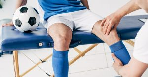 Chiropractor Checking Soccer Player's Knee   Why Athletes Should See A Chiropractor   Upstate Spine & Sport