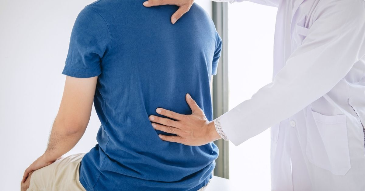Chiropractor Helping With Lower Back Pain | Upstate Spine & Sport