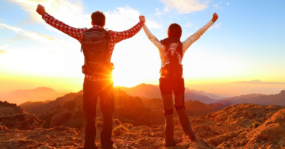 Couple Celebrating A Successful Hike | Speed Up Recovery From An Injury